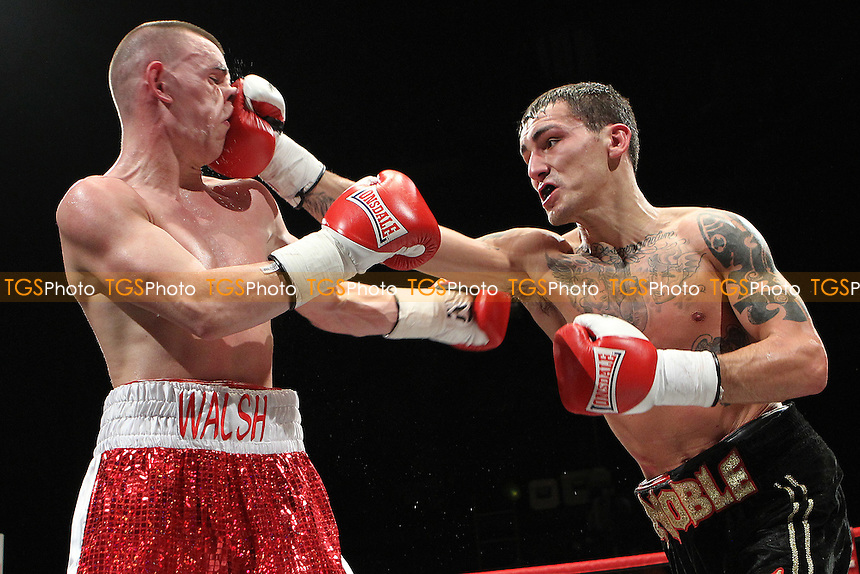Dee Walsh (red trunks) beats Lee Noble on points in a Boxing contest at the Magna Centre, Rotherham, promoted by Hennessy Sports - 18/02/12 - MANDATORY CREDIT: Chris Royle/TGSPHOTO - Self billing applies where appropriate - 0845 094 6026 - contact@tgsphoto.co.uk - NO UNPAID USE..