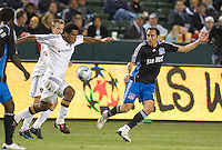 Mike Randolph carries the ball in front of Ramiro Corrales,.San Jose Earthquakes vs Los Angeles Galaxy, April 4, 2008, in Carson California. The Galaxy won 2-0.