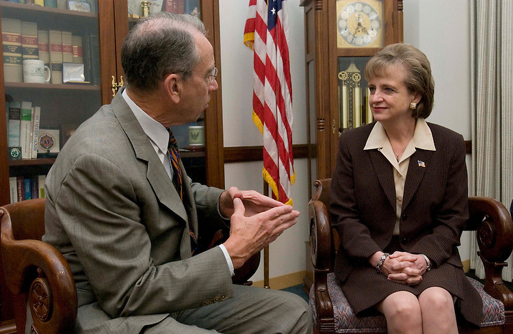 10/04/05.SUPREME COURT NOMINEE HARRIET MIERS--White House counsel Harriet Miers, President Bush's nominee for the U.S. Supreme Court, during a photo opp with Senate Judiciary member Charles E. Grassley, R-Iowa, in his office.. CONGRESSIONAL QUARTERLY PHOTO BY SCOTT J. FERRELL