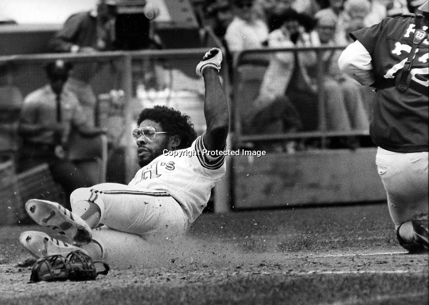 Oakland A's Mitchell Page slides into home.<br />(1981 photo by Ron Riesterer)