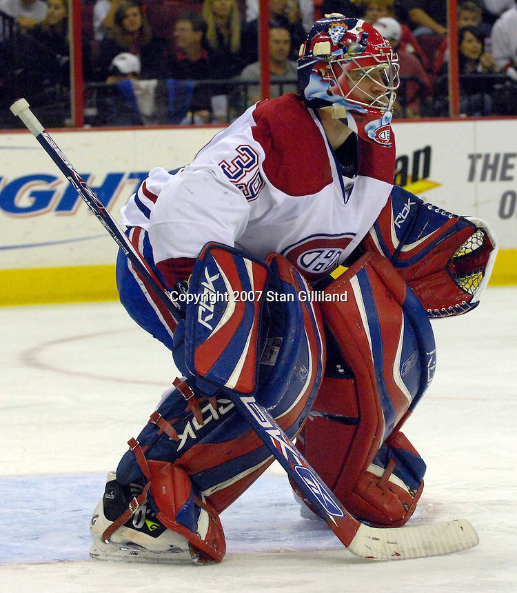 Montreal Canadiens' goalie Cristobal Huet watches the action during their game with Carolina Friday, Oct. 26, 2007 in Raleigh, NC. The Canadiens won 7-4.