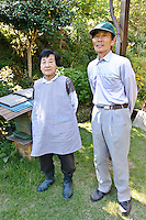 Beekeeper Masahiro Tominaga and his wife, Inadani, Nagano Pref, Japan, September 24, 2011. Inadani is home to Japanese honey-bee farms. The bees feed off red-soba flowers and the exceptionally high-quality honey they produce is sold at a premium.