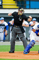 Home plate umpire Skylar Shown calls a batter out on strikes during the Appalachian League game between the Pulaski Mariners and the Burlington Royals at Burlington Athletic Park on July 20, 2013 in Burlington, North Carolina.  The Royals defeated the Mariners 6-5.  (Brian Westerholt/Four Seam Images)