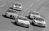Geoff Bodine leadsBobby Allison, Dale Earnhardt, Richard Petty abd Bill Elliott into turn 3 at Atlanta in November 1982. (Photo by Brian Cleary)