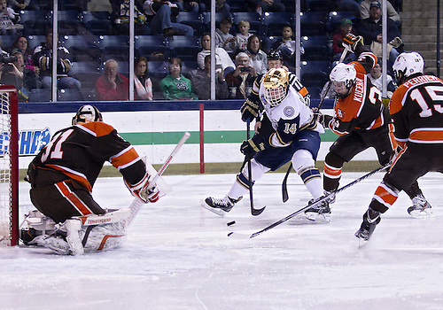 March 01, 2013:  Notre Dame center Thomas DiPauli (14) drives to the net as Bowling Green defenseman Connor Kucera (3) defends during NCAA Hockey game action between the Notre Dame Fighting Irish and the Bowling Green Falcons at Compton Family Ice Arena in South Bend, Indiana.  Notre Dame defeated Bowling Green 4-3.