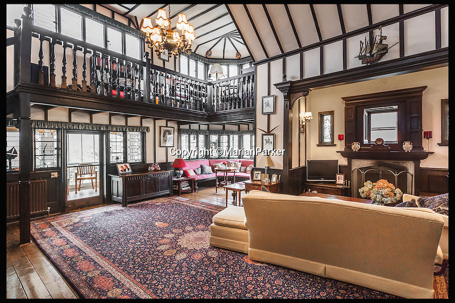 BNPS.co.uk (01202 558833)<br /> Pic: MarianParker/BNPS<br /> <br /> All original double height drawing room.<br /> <br /> Colonial time capsule - Yours for &pound;1 million.<br /> <br /> The finest original bungalow that remains from Victorian time's is for sale - with a lot more style &amp; grandeur than its hum-drum modern descendents.<br /> <br /> Pleasaunce Cottage in East Grinsted has been meticulously maintained over decades to keep much of its original charm with authentic wood panelling and stained glass windows.<br /> <br /> It is said to be the finest example of a colonial India-style bungalow that exists in this country today and features on the Society for the Protection of Ancient Buildings (SPAB) property list.