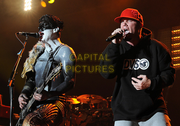 LIMP BIZKIT - WES BORLAND & FRED DURST.Performs as part of the Rock On The Range festival held at Columbus Crew Stadium, Columbus, Ohio, USA.              .May 23rd, 2010        .stage concert live gig performance music half length black top sweatshirt red baseball cap hat goatee facial hair singing guitar guitarist make-up body paint.CAP/ADM/JN.©Jason L Nelson/AdMedia/Capital Pictures.
