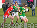 Kerry Denise Hallisey tackled by Cork Roisin Phelan, watched by Kerry Louise Ní Mhuirtceartaigh during the NFL Div. 1 match at Pairc an Aghasaigh, Dingle, on Sunday afternoon.
