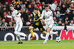 Theo Hernandez of Real Madrid (R) fights for the ball with Borussia Dortmund Midfielder Christian Pulisic (C) during the Europe Champions League 2017-18 match between Real Madrid and Borussia Dortmund at Santiago Bernabeu Stadium on 06 December 2017 in Madrid Spain. Photo by Diego Gonzalez / Power Sport Images