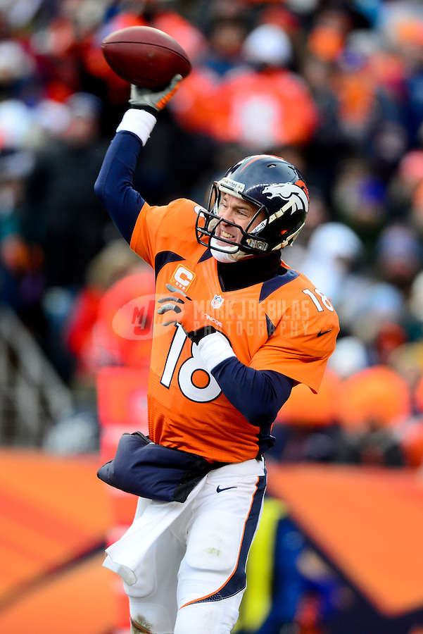 Jan 12, 2013; Denver, CO, USA; Denver Broncos quarterback Peyton Manning (18) throws a pass in the first half against the Baltimore Ravens during the AFC divisional round playoff game at Sports Authority Field.  Mandatory Credit: Mark J. Rebilas-
