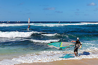 Windsurfers at Ho'okipa Beach on Maui.
