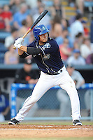 Asheville Tourists shortstop Pat Valaika #16 swings at a pitch during opening night game against the Delmarva Shorebirds at McCormick Field on April 3, 2014 in Asheville, North Carolina. The Tourists defeated the Shorebirds 8-3. (Tony Farlow/Four Seam Images)