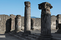 Basilica, Pompeii, 2nd century BC. Located on the South West side of the Forum it is one of the oldest remaining examples of a Roman Basilica. Some of the many Ionic columns of the building are shown here in the late afternoon light