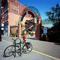 Victoria, BC, Vancouver Island, British Columbia, Canada - Historic Market Square Shopping District in Old Town, and Bike locked to Pole