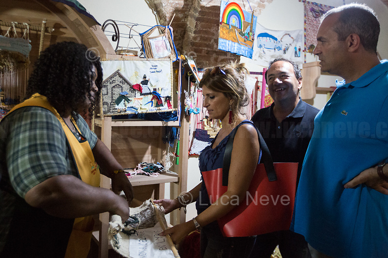 """(From L to R) Lucano (Riace), De Magistris (Naples).<br /> <br /> Riace (Calabria, Italy), 04/08/2018. Visiting Riace for the third day of the """"Riace in Festival"""", 'Festival delle Migrazioni e delle Culture Locali' (Festival of Migration and Local Cultures). Attending the festival, amongst others, were the Mayor of Napoli Luigi De Magistris and the Mayor of Barcelona Ada Colau, debating with the Mayor of Riace, Domenico 'Mimmo' Lucano, about the so called """"migration crisis"""", as well as the now famous """"Modello Riace"""" (The Riace Model: how to welcome and work with Migrants to invest in building a future together). Other speakers included: Tiziana Barillà, Journalist at """"il Salto"""" (1) and Author of the book """"Mimi Capatosta. Mimmo Lucano e il modello Riace"""" (2), Magistrates Riccardo De Vito and Emilio Sirianni (in turn President and Member of Magistratura Democratica). Chair of the event was Ilaria Bonaccorsi, Historian & Journalist at """"il Salto"""".<br /> From the Festival website: """"RIACE in FESTIVAL, is an event born in the wake of the policy of reception and resettlement of refugees and asylum seekers that the city administration of the """"Riace Bronzes'"""" town has been implementing for years. [...] The festival aims to be a concrete initiative that, through the universal language of cinema and the arts, promotes the exchange and mutual knowledge to counteract forms of closure and racism, drawing attention to the innovative path that the municipal administration of Riace has started by combining the reception of migrants with the revival of its territory and giving the image of an unpublished Calabria, different from that of the black chronicle>>.<br /> Riace is a small village in the province of Reggio Calabria. It's famous because on the 16 August 1972...<br /> <br /> (For the full caption read the ARTICLE at the the beginning of this story)"""