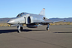 A McDonnel Douglas F-4E Phantom II sits on the ramp during the 2004 Reno National Championship Air Racer at Stead Field in Nevada. Over 5000 of the twin engine, tandem seat, mach 2 fighters were originally built starting in 1961 for the United States Navy and Air Force. The aircraft was also exported to Australia, Egypt, Germany, Greece, Iran, Israel, Japan, South Korea, Spain, Turkey, and the United Kingdom. The United States retired its last Phantom in 1996 and export countries are the only operators of the aircraft type. Though the aircraft pictured is in U.S. markings it is actually a German aircraft flown by German Air Force pilots for training.