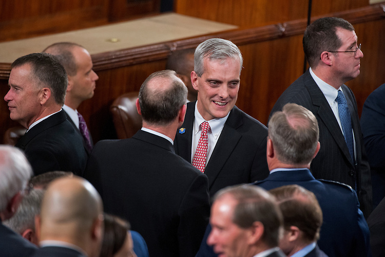 UNITED STATES - JANUARY 20: White House Chief of Staff Denis McDonough greets guests in the Capitol's House chamber before President Barack Obama's State of the Union address, January 20, 2015. (Photo By Tom Williams/CQ Roll Call)