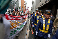 Student activist with Zengakren (All Japan Federation of Students' Autonomous Body) and police at a demo march outside Hosei university, Ichigaya, Tokyo, Japan Friday April 23rd 2010