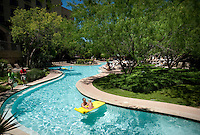 Guests enjoy their stay at a pool at the Four Seasons Resort and Spa in Irving, Texas, Sunday, May 2, 2010. Four Seasons couldn't abstain from cost cutting in this downturn as it had in previous recessions because the worst hotel market in decades left the company last year with a 26% decline in revenue per available room in the U.S. Similarly, its occupancy fell to 57% from its usual perch above 70%...CREDIT: Matt Nager for The Wall Street Journal