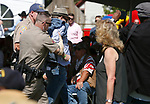 Douglas County Sheriff's deputies remove a protestor as U.S. Sen. Dean Heller speaks at the 4th annual Basque Fry in Gardnerville, Nev., on Saturday, Aug. 25, 2018. Hosted by the Morning in Nevada PAC, the event is a fundraiser for conservative candidates and issues and includes traditional Basque dishes like deep-fried lamb testicles.(Cathleen Allison/Las Vegas Review Journal)
