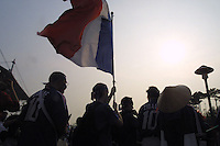 French national team supporters, mingle with other fans  outside of the Seoul World Cup Stadium before the opening day match between France and Senagal on Friday May 31st, 2002 in Seoul, South Korea.