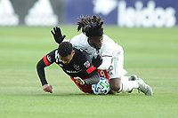WASHINGTON, DC - FEBRUARY 29: Washington, D.C. - February 29, 2020: Ola Kamara #9 of D.C. United battles the ball with Lalas Abubakar #6 of the Colorado Rapids. The Colorado Rapids defeated D.C. Untied 2-1 during their Major League Soccer (MLS)  match at Audi Field during a game between Colorado Rapids and D.C. United at Audi Field on February 29, 2020 in Washington, DC.