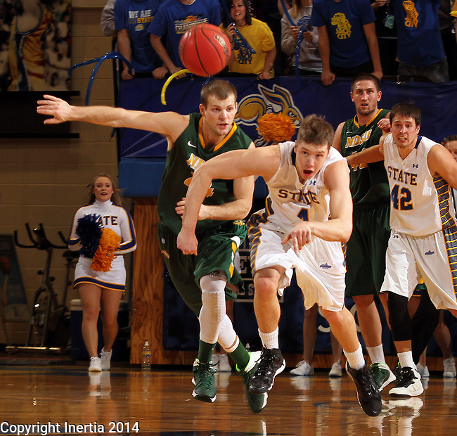 BROOKINGS, SD - JANUARY 25:  Jake Bittle #4 from South Dakota State University battles for the loose ball with Taylor Braun #24 from North Dakota State University in the first half of their game Saturday afternoon at Frost Arena in Brookings. (Photo by Dave Eggen/Inertia)