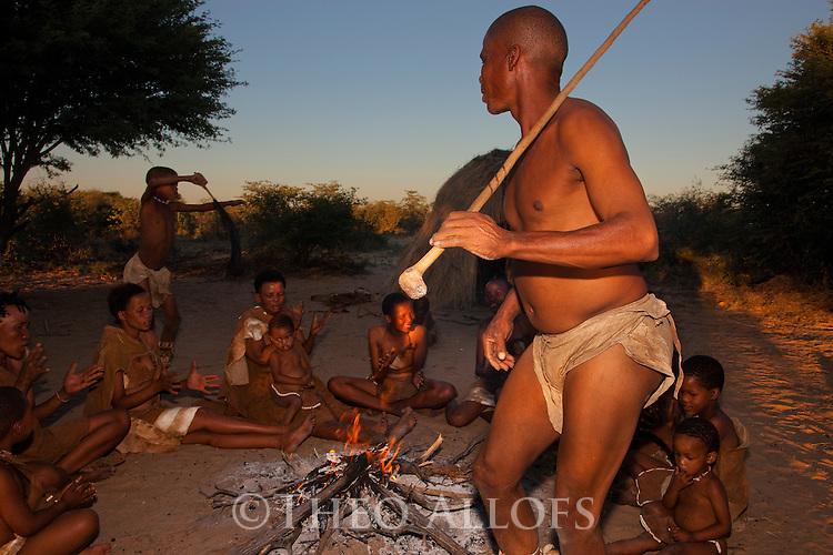 Botswana, Kalahari, bushmen (San) singing and dancing around fire