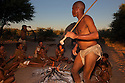 Botswana, Kalahari, bushmen (San) singing and dancing around fire