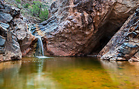 "A small stream of water falls into a pool along the trail going up into No Thoroughfare Canyon in Colorado National Monument.  The trail extends from the ""Devils Kitchen"" found at the first part of the trail."