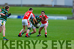 St Brendans Alan O'Donoghue runs into a sea of red as West Kerry's Padraid Rohan and Gareth Ó Nuanáin closes down his path in the qualifier game in the Senior Football Championship game on Sunday.