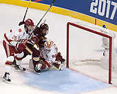 Blake Hillman (DU - 25), Avery Peterson (UMD - 11), Tanner Jaillet (DU - 36) - The University of Denver Pioneers defeated the University of Minnesota Duluth Bulldogs 3-2 to win the national championship on Saturday, April 8, 2017, at the United Center in Chicago, Illinois.