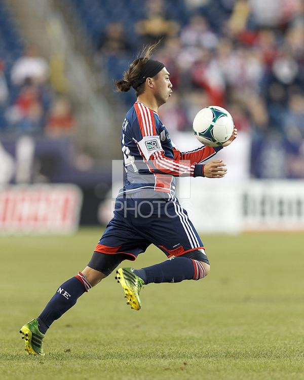 New England Revolution midfielder Lee Nguyen (24) collects a pass. In a Major League Soccer (MLS) match, Montreal Impact (white/blue) defeated the New England Revolution (dark blue), 4-2, at Gillette Stadium on September 8, 2013.