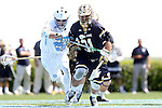 23 April 2016: Notre Dame's P.J. Finley (31) and North Carolina's Stephen Kelly challenge for a draw. The University of North Carolina Tar Heels hosted the University of Notre Dame Fighting Irish at Kenan Stadium in Chapel Hill, North Carolina in a 2016 NCAA Division I Men's Lacrosse match. UNC won the game 17-15.