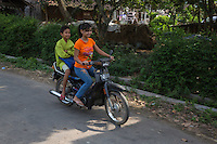 Borobudur, Java, Indonesia.  Young Javanese Children on a Motorbike.