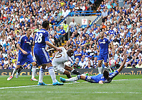 Andre Ayew of Swansea scores his sides first goal    during the Barclays Premier League match between  Chelsea and Swansea  played at Stamford Bridge, London
