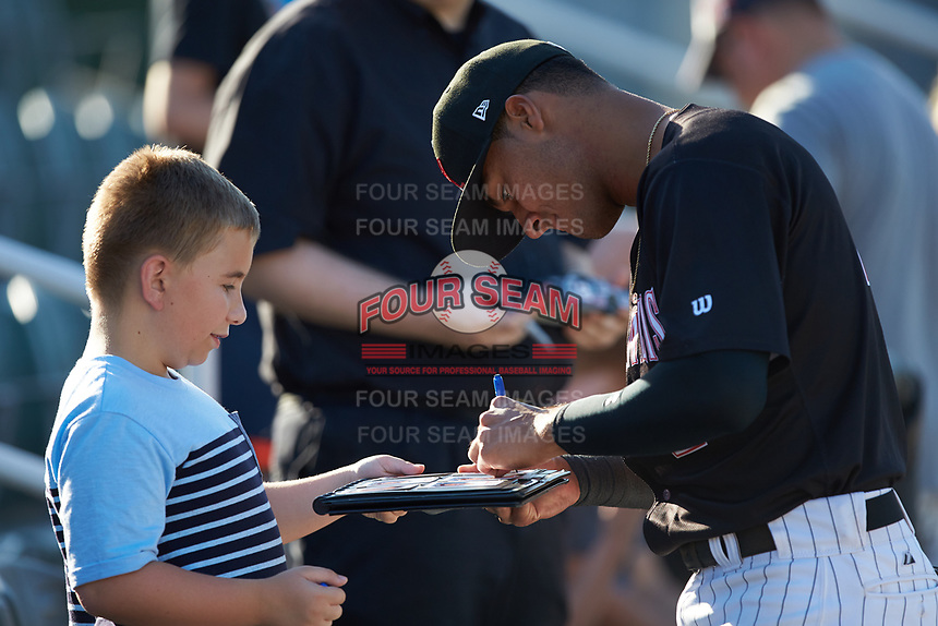 Lenyn Sosa (2) of the Kannapolis Intimidators signs autographs prior to the game against the Augusta GreenJackets at Kannapolis Intimidators Stadium on June 21, 2019 in Kannapolis, North Carolina. The Intimidators defeated the GreenJackets 6-1. (Brian Westerholt/Four Seam Images)