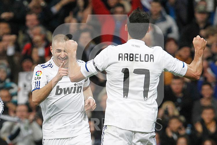 Real Madrid's Karim Benzema (l) and Alvaro Arbeloa celebrate goal during La Liga match.March 12,2011. (ALTERPHOTOS/Acero)
