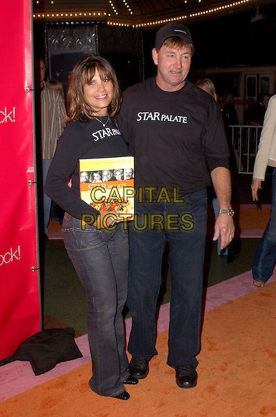 LYNNE SPEARS & JAMIE SPEARS.Attend Lifetime Television's 5th Annual Women Rock! Concert for the fight against breast cancer held at The Wiltern Theatre in Los Angeles, California, USA, September 28 2004..full length Britney's parents mother father.Ref: DVS.www.capitalpictures.com.sales@capitalpictures.com.©Debbie VanStory/Capital Pictures .
