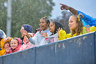 Annapolis, MD - September 8, 2018: Young Navy fans enjoy the rain and a Midshipmen touchdown during game between Memphis and Navy at  Navy-Marine Corps Memorial Stadium in Annapolis, MD. (Photo by Phillip Peters/Media Images International)