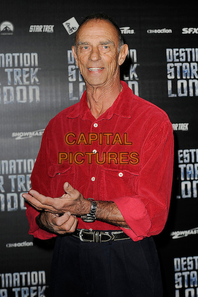 Marc Alaimo .attending 'Destination Star Trek' London, Excel, London, England, UK, .19th October 2012..half length red shirt hand .CAP/MAR.© Martin Harris/Capital Pictures.