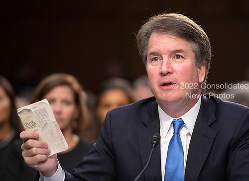 Judge Brett Kavanaugh holds a tattered copy of the United States Constitution that he carries with him in his pocket as he testifies before the US Senate Judiciary Committee on his nomination as Associate Justice of the US Supreme Court to replace the retiring Justice Anthony Kennedy on Capitol Hill in Washington, DC on Wednesday, September 5, 2018.<br /> Credit: Ron Sachs / CNP<br /> (RESTRICTION: NO New York or New Jersey Newspapers or newspapers within a 75 mile radius of New York City)