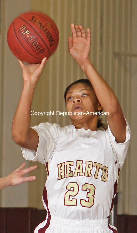 WATERBURY, CT-25 January 012514MK18 ACTIONMAN Sacred Heart's Mikyla Jacobs puts up a shot during NVL girl's basketball action Saturday evening at Sacred Heart High School.  Sacred Heart defeated Torrington 50-42. Michael Kabelka / Republican-American