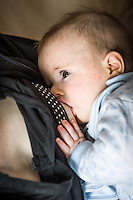 A close-up of a baby breastfeeding.<br /> <br /> 15/05/2012<br /> Hampshire, England, UK