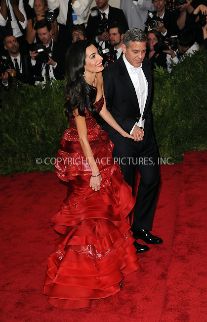 WWW.ACEPIXS.COM<br /> <br /> May 4, 2015...New York City<br /> <br /> George Clooney and Amal Clooney attending the Costume Institute Benefit Gala celebrating the opening of China: Through the Looking Glass at The Metropolitan Museum of Art on May 4, 2015 in New York City.<br /> <br /> By Line: Kristin Callahan/ACE Pictures<br /> <br /> <br /> ACE Pictures, Inc.<br /> tel: 646 769 0430<br /> Email: info@acepixs.com<br /> www.acepixs.com