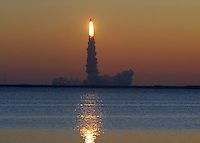 Space Shuttle Discovery lifts off at sunrise to begin the STS 102 Mission, Kennedy Space Center, Titiusville, FL,  March 2001.  (Photo by Brian Cleary/www.bcpix.com)