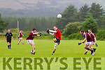Glenbeigh/Glencar's Darran O'Sullivan gets into position between Dromids Kealan Falvey & Denis Shine O'Sullivan as he makes this score in their Junior Premier Club Championship clash on Sunday.
