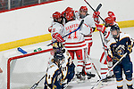MADISON, WI - SEPTEMBER 29: Teammates celebrate Jinelle Zaugg #8 of the Wisconsin Badgers women's hockey goal against the Quinnipiac Bobcats at the Kohl Center on September 29, 2006 in Madison, Wisconsin. The Badgers beat the Bobcats 3-0. (Photo by David Stluka)