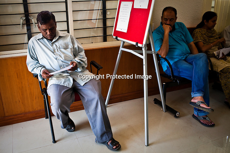 Local residents wait in queue during national identity enrollment in Mysore city in Karnataka, India. Photograph: Sanjit Das/Panos