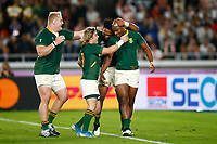 Faf de Klerk and Lukhanyo Am with Makazole Mapimpi during the Rugby World Cup Final match between South Africa Springboks and England Rugby World Cup Final at the International Stadium in Yokohama, Japan on Saturday, 2 November 2019. Photo: Steve Haag / stevehaagsports.com